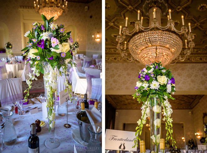 Tall wedding centrepieces for a wedding breakfast at Walton Hall, Warwickshire.