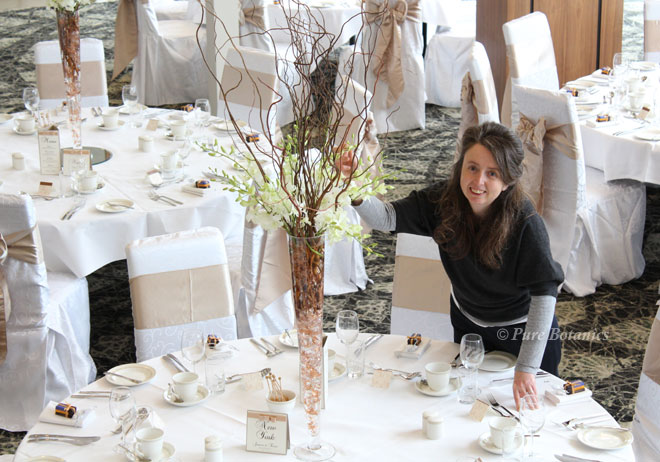 Setting up tall wedding centrepieces at Ashorne Hill, Leamington Spa.