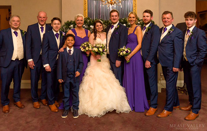 Bridal party with a purple wedding theme at Walton Hall.