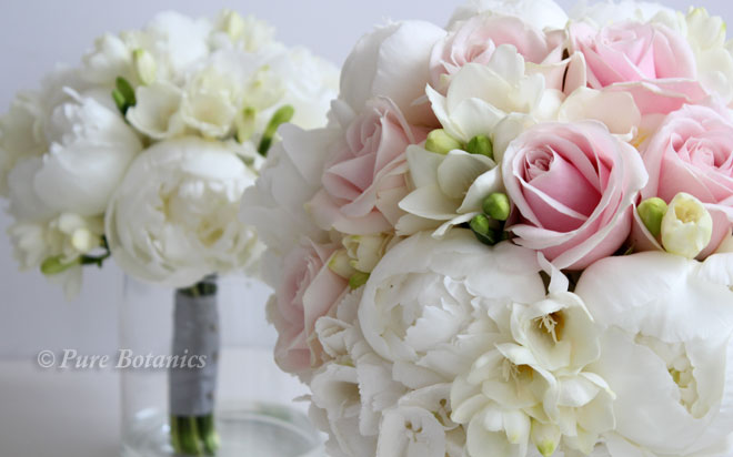 Peonies, roses, freesias and hydrangeas in spring wedding bouquets.