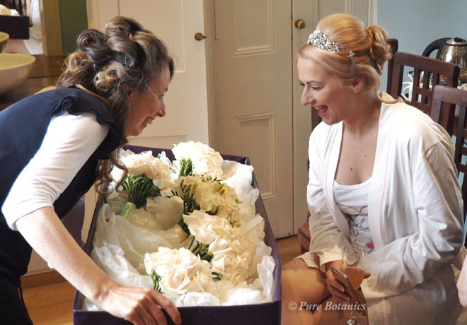 Cindy delivering the bouquets to the bride on the morning of her wedding.