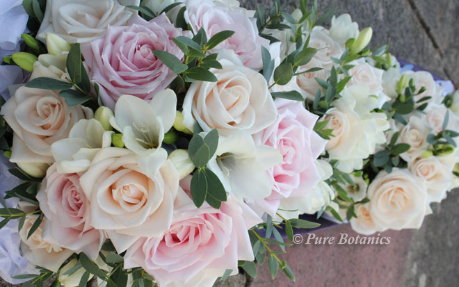 Cream and blush pink rose wedding bouquets.