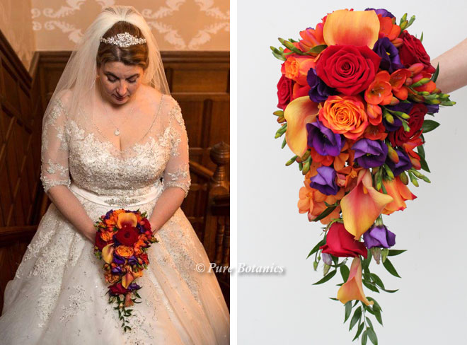 Red and orange flowers in a shower bouquet with a hint of purple.