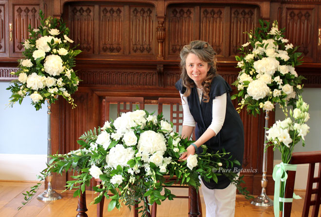 Cindy from Pure Botanics setting up wedding flowers for a civil ceremony.