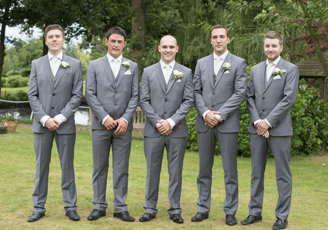 Groomsmen wearing cream rose buttonholes at Nailcote hall.