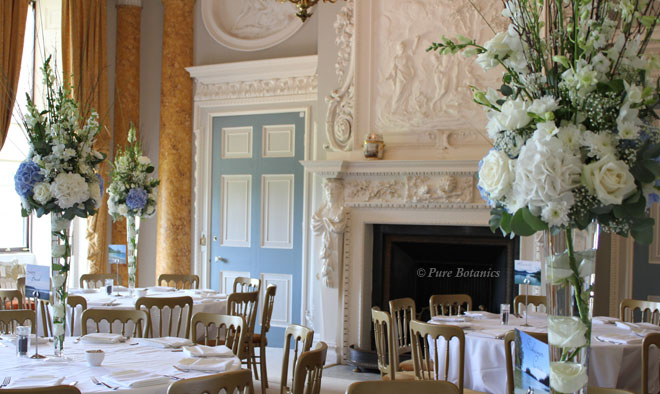 Tall blue and white hydrangea wedding flower centrepieces at Stoneleigh Abbey.