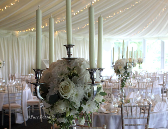 Hydrangea and rose wedding candelabra centrepieces