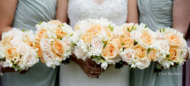 Peach and cream wedding posy bouquets at Nailcote Hall, Coventry.