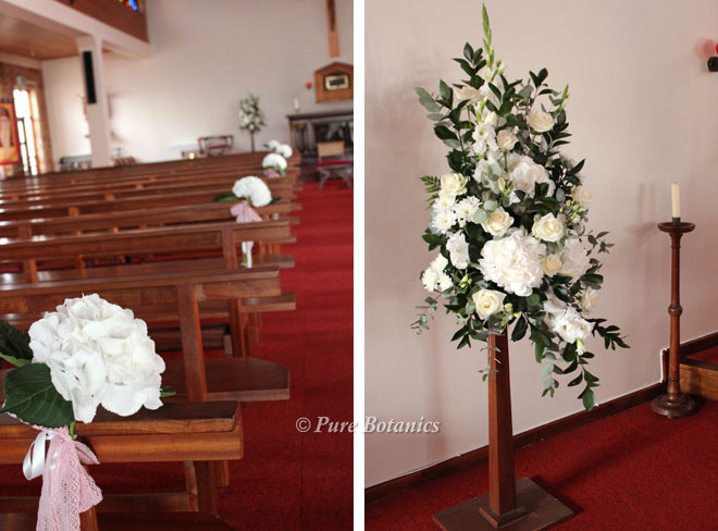Hydrangea pew ends and pedestal arrangement for a church wedding ceremony.