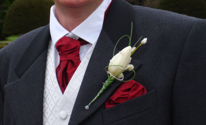 Tulip buttonhole for a winter wedding.