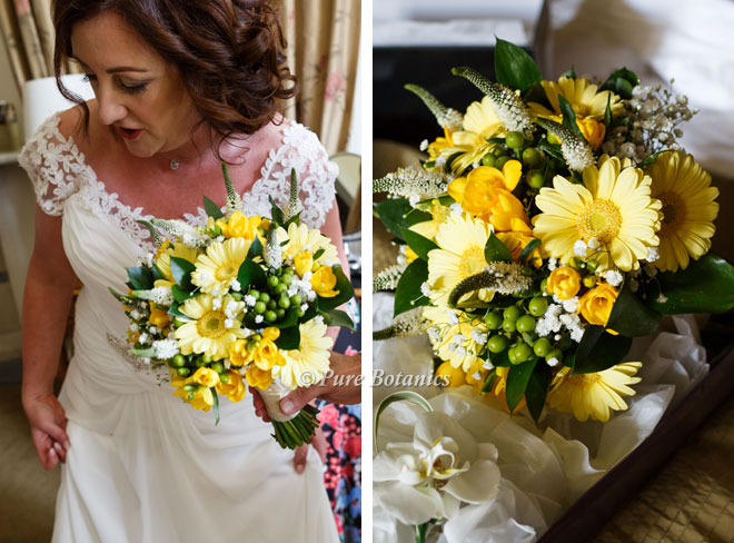 Yellow gerberas and freesias for a country style bridal bouquet.