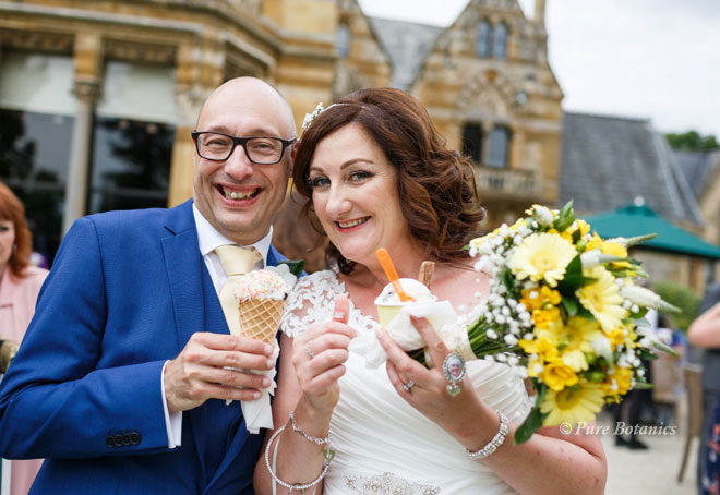 Couple celebrating their wedding at Ettington Park hotel, Stratford.