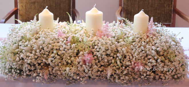 romantic gypsophila top table arrangement