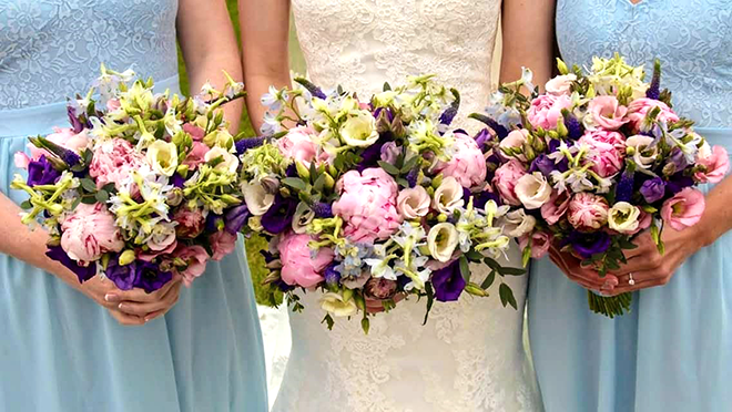 Blue pink and purple bridal handtied posy bouquets