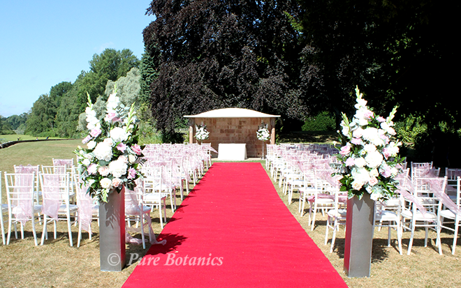 Outdoor wedding ceremony flowers at Coombe Abbey