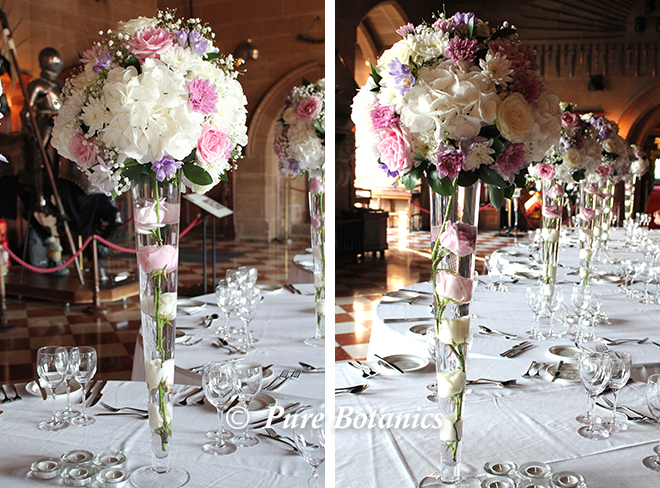 Tall wedding centrepieces at Warwick Castle.